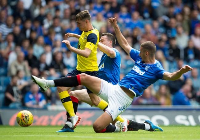 Gavin Whyte is tackled by George Edmundson and Nikola Katic  Picture: Ian Rutherford/PA Wire