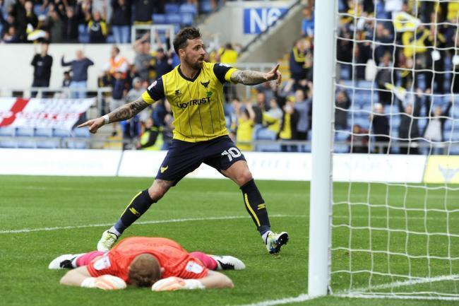 Chris Maguire celebrates his last-minute winner against Peterborough in 2016