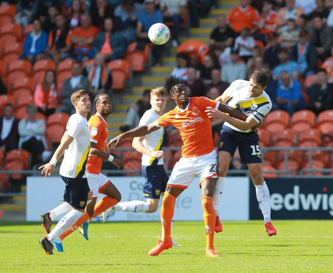 John Mousinho heads clear under pressure in Oxford's defeat at Blackpool Picture:Richard Parkes.