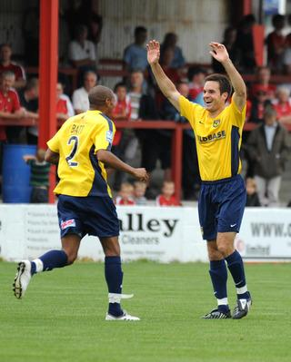 Simon Clist acknowledges his stunning volley during Oxford United's win at Ebbsfleet on Saturday, as teammate Damian Batt races to join in the celebrations