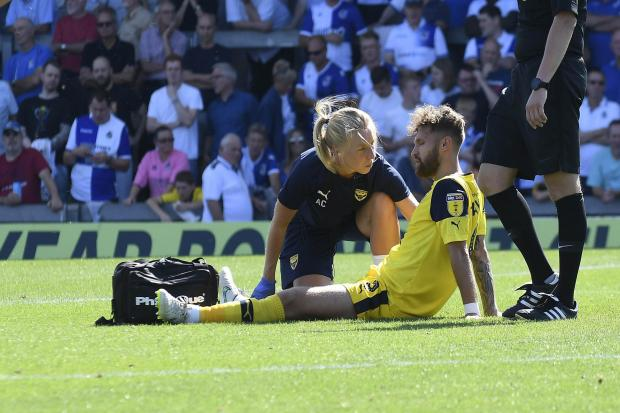 Oxford United's Matty Taylor gets treatment before coming off at Bristol Rovers with a groin injury  Picture: David Fleming