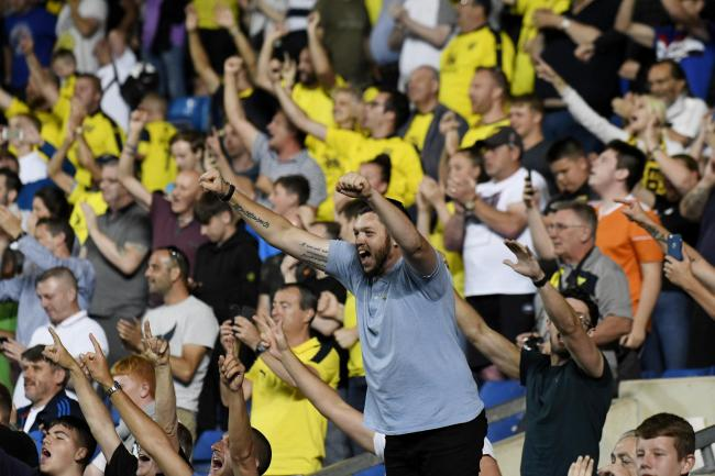 Oxford United fans celebrate the penalty shoot-out victory over Millwall in the second round
