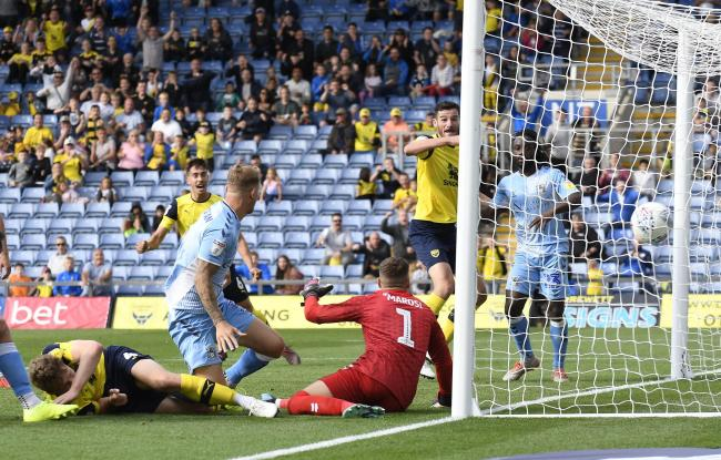 Oxford United celebrate as the ball goes in via Coventry City defender Fankaty Dabo for a 94th-minute equaliser  Picture: David Fleming