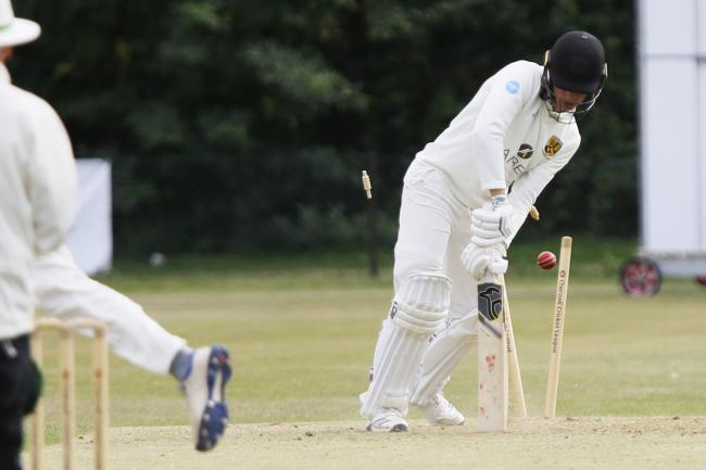 Cumnor's Samuel Cross is bowled by Joe Butcher during his side's win at Abingdon Vale Picture: Ed Nix