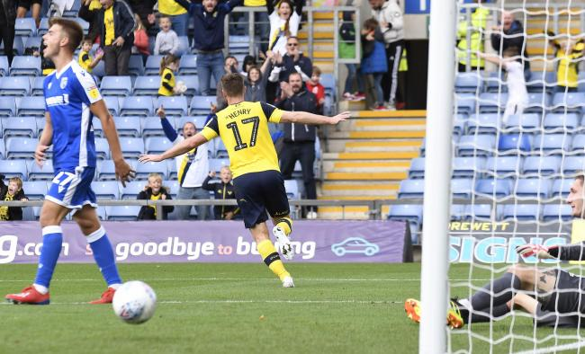James Henry celebrates putting Oxford United 3-0 up against Gillingham  Picture: David Fleming