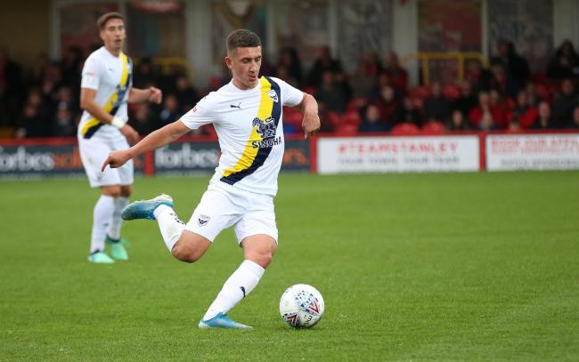 Oxford United goalscorer Cameron Brannagan looks for a teammate at Accrington Stanley   Picture: Richard Parkes