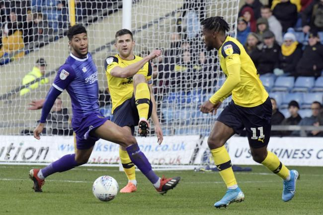 John Mousinho clears the danger for Oxford United against Shrewsbury Town  Picture: David Fleming