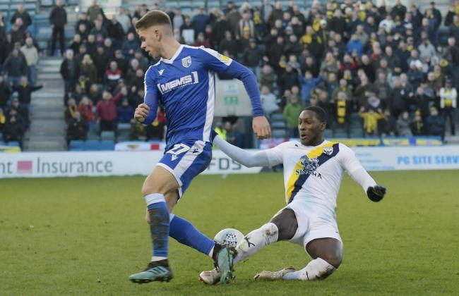 Oxford United's Shandon Baptiste puts in a challenge against Gillingham's Jack Tucker  Picture: David Fleming