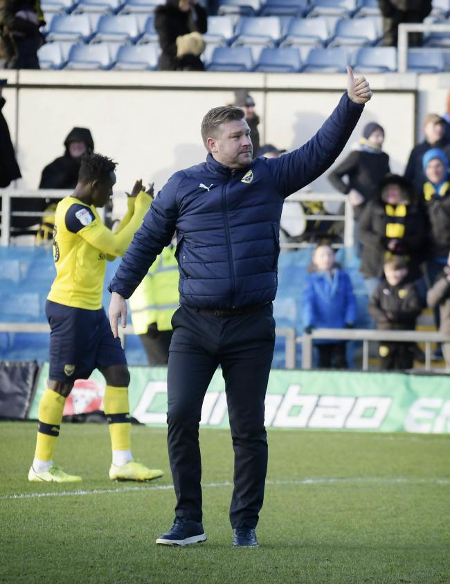 Oxford United boss Karl Robinson thanks the home supporters after the game   Picture: David Fleming
