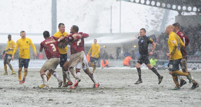 Michael Raynes is involved in an altercation during Oxford United's snow-hit trip to Northampton Town in 2013   Picture: Jon Lewis
