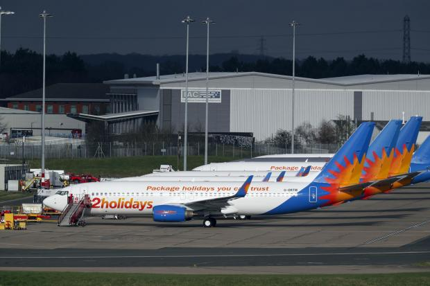 Banbury Cake: AIRLINE: Several Jet2 planes have been parked up at Birmingham Airport during the pandemic. Picture: Steve Parsons/PA