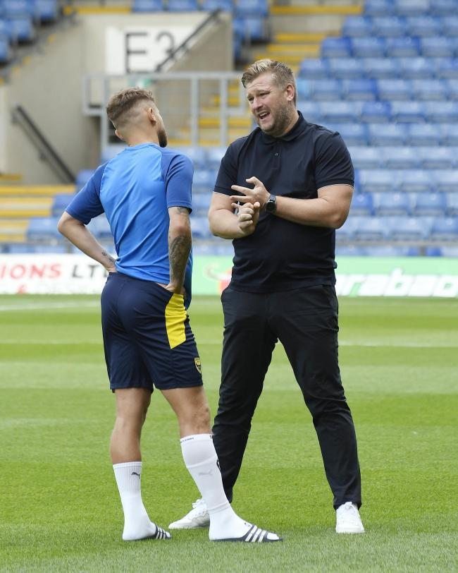 Oxford United head coach Karl Robinson talks to Matty Taylor earlier this season  Picture: David Fleming