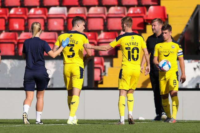 Oxford United's Josh Ruffels is helped off the pitch in the second half   Picture: James Williamson