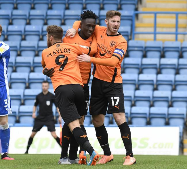 Dan Agyei (centre) celebrates scoring against Gillingham on Saturday with Matty Taylor (left) and James Henry  	Picture: David Fleming