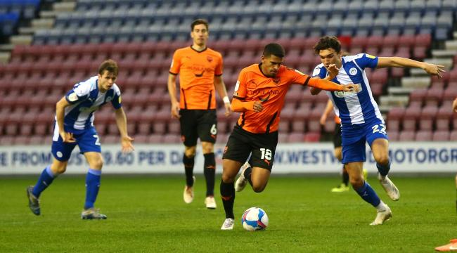 Marcus McGuane on the run against Wigan Athletic Picture: Richard Parkes