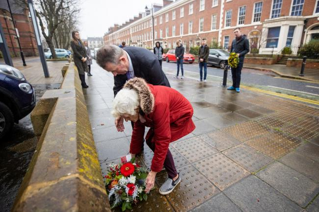 Maura Babbington and her son Marcus lay a wreath ahead of the anniversary of the death of lawyer Edgar Graham