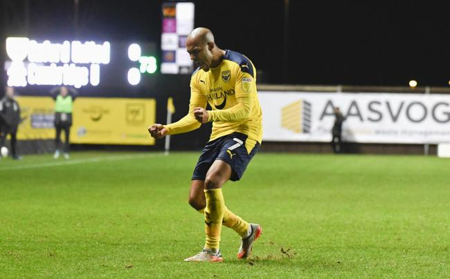 Rob Hall celebrates his match-winner for Oxford United against Cambridge United Picture: David Fleming