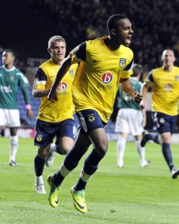 Banbury Cake: Oxford United teenager Rob Hall celebrates the first of his double against Plymouth on Tuesday night