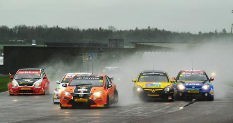 Jason Plato (far right) battles it out at a rain-lashed Thruxton as the cars send the spray flying