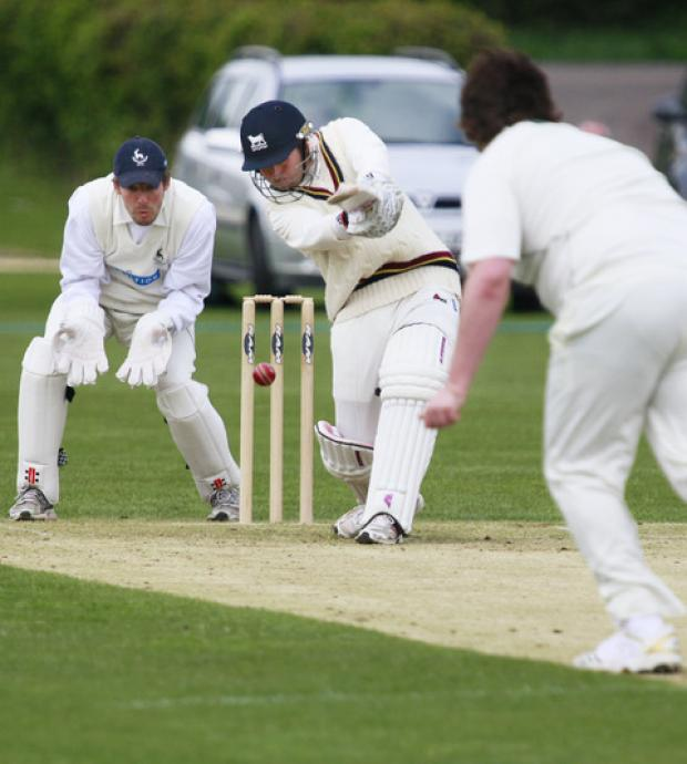 Oxfordshire batsman Richard Kaufman drives straight back at Hertfordshire bowler Will Jones yesterday