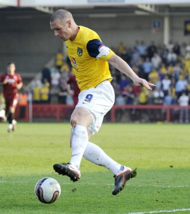 Oxford United striker James Constable in action