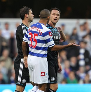 Chelsea captain John Terry, right, speaking to QPR's Anton Ferdinand