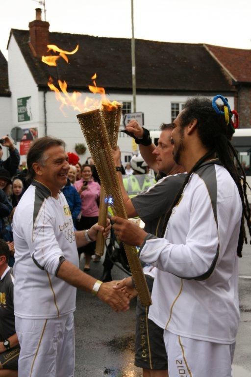 Raymond Blanc hands over the torch and shakes hands