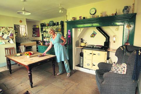 Ag MacKeith in her kitchen as it is today. Picture: OX53040 Antony Moore