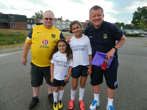 Les Taylor (left) pictured with manager Chris Wilder and two local mascots from Oxford United's opening game against Seacoast United Mariners last Tuesday