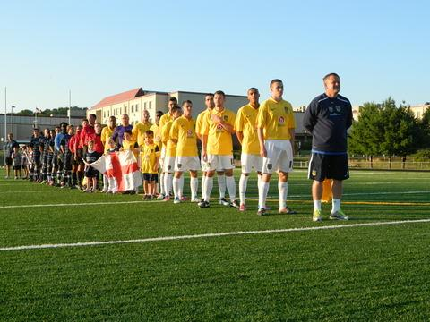 Oxford United boss Chris Wilder, seen here lining-up for the anthems ahead of  Monday's friendly against the Jim Dedeus All Star XI, says he has been delighted with their hosts during the club's pre-season US tour