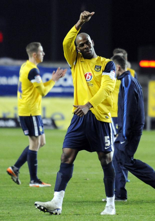 Oxford United defender Michael Duberry salutes the U's fans after a typically committed display against Accrington Stanley last season