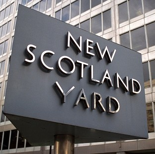Scotland Yard said a 60-year-old man was arrested on suspicion of conspiring to intercept communications