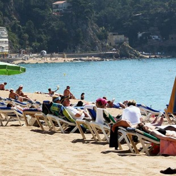 Banbury Cake: A man and a boy have drowned off the coast of Majorca, the Foreign Office says