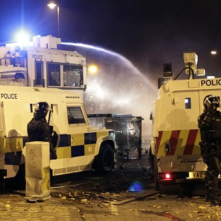 Police use water cannon on loyalist rioters in north Belfast (AP)