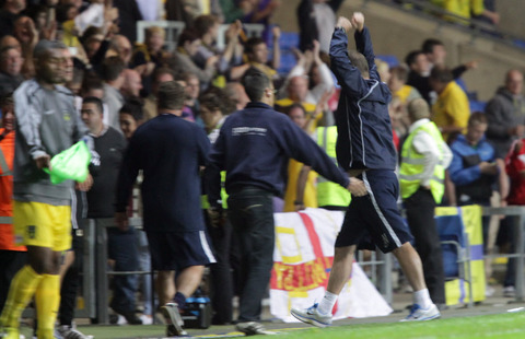 Chris Wilder celebrates at the final whistle