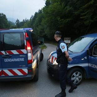 Gendarmes block access to the scene near Chevaline in the French Alps (AP)