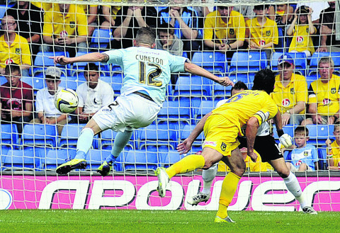 Jamie Cureton fires in Exeter's first goal