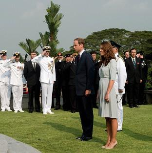 The Duke and Duchess of Cambridge pay their respects at the Kranji War Memorial in Singapore (AP)