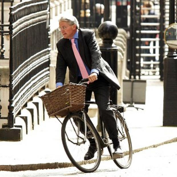 Andrew Mitchell lost his temper when police officers stopped him riding his bike through the main gates outside Number 10