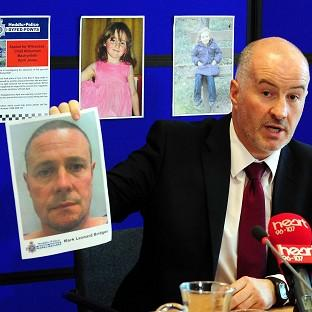 Banbury Cake: Detective Superintendent Reg Bevan holding up a photo of Mark Bridger who has been arrested during the probe into the abduction of April Jones