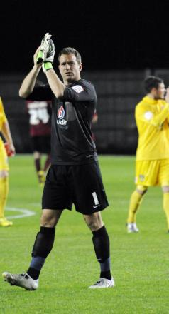 Ryan Clarke applauds the fans after United's win over Wimbledon