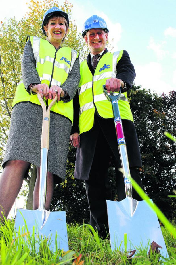 Principal Sally Dicketts cuts the first sod with Francis Shiner, managing director of SDC