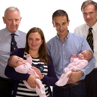 Angela and Daniel Formosa, with surgeon Edward Kiely and Professor Agostino Pierro, holding their twins Rosie and Ruby