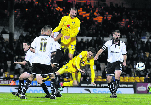 Harry Worley (centre) and teammate Johnny Mullins in action for Oxford United in Monday's 3-0 defeat at Port Vale – their seventh loss in nine league games