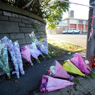 Floral tributes outside the Fire Station in Ely, Cardiff, where Karina Menzies, 32, was killed in a multiple hit and run incident