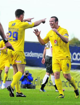 Tom Craddock applauds the efforts of strike partner James Constable after scoring the first of his four goals against Ac