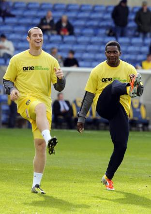 Jon-Paul Pittman (right) wearing the Kick It Out campaign t-shirt before Saturday's 5-0 win over Accrington