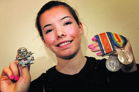 Chloe Coules, from Banbury with her great-great grandfathers' medals and cap badge