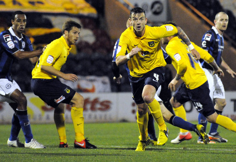 Johnny Mullins (left) and Michael Raynes in the thick of the action at Rochdale
