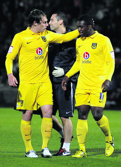 Jon-Paul Pittman (right) is consoled by Adam Chapman after getting injured against Cheltenham
